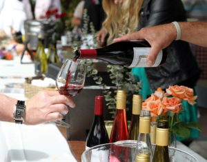 Photo from Visit Pismo Beach of a Pouring done for community event Epicurean Delights