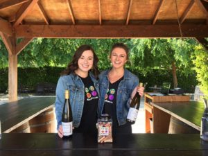 Our very own Michelle and Emma loved hanging out with the dogs and serving wine at our Wine and Paws event!